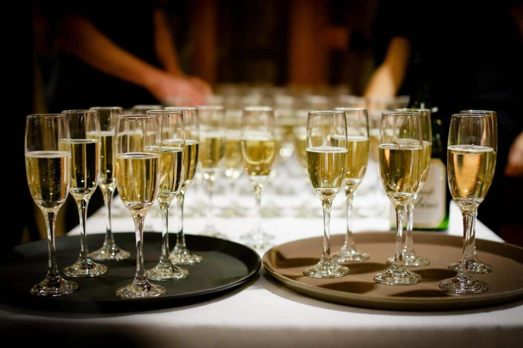 Serving Prosecco at an event.