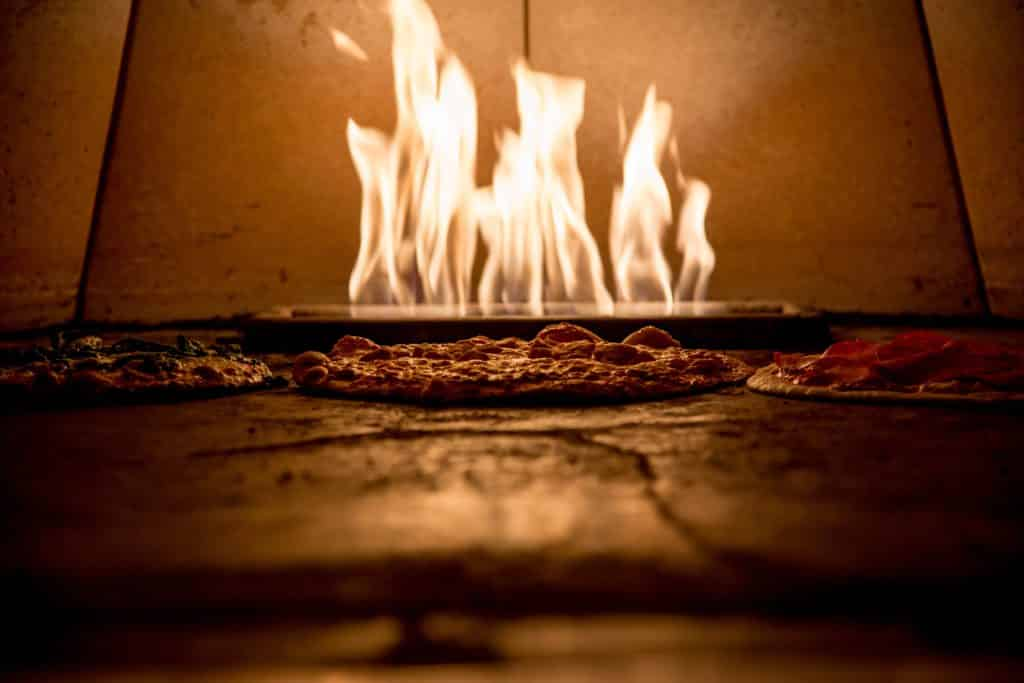 Fire cooked pizza in Italy