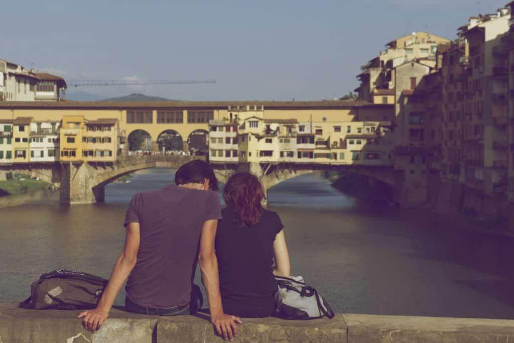 Lovers sit on Ponte Vecchio