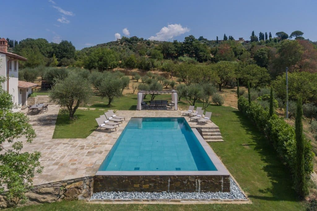 The pool at Casa Namaste is surrounded by views of olive groves.